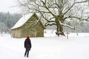 Lena admiring the chapel at Mas Saint-Jean on a snowy morning...