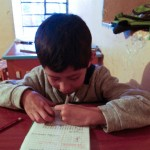 Random image: Luis Working on Homework